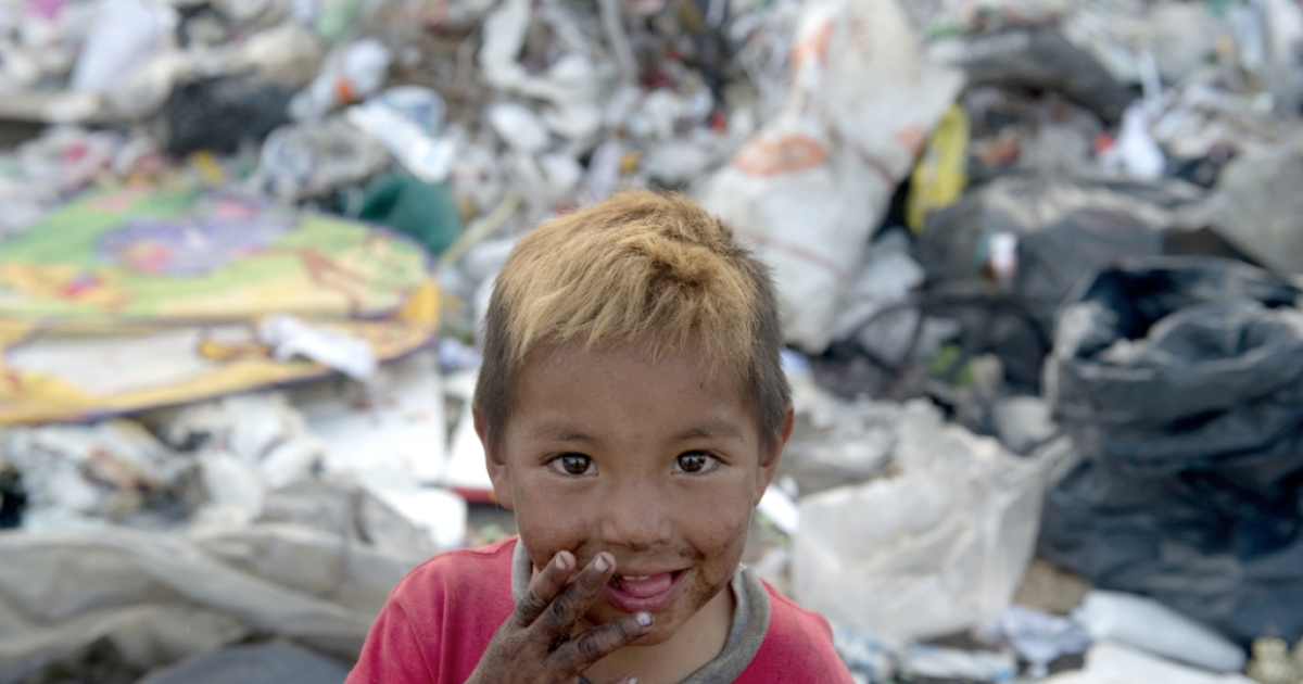 A little scavenger boy smiles at the 'Bordo Poniente' garbage dump in Mexico City, on January 18, 2012. Some six thousand tons of garbage from the second most-populated city in the world has been deposited here for about twenty five years until its closure last month.</p>