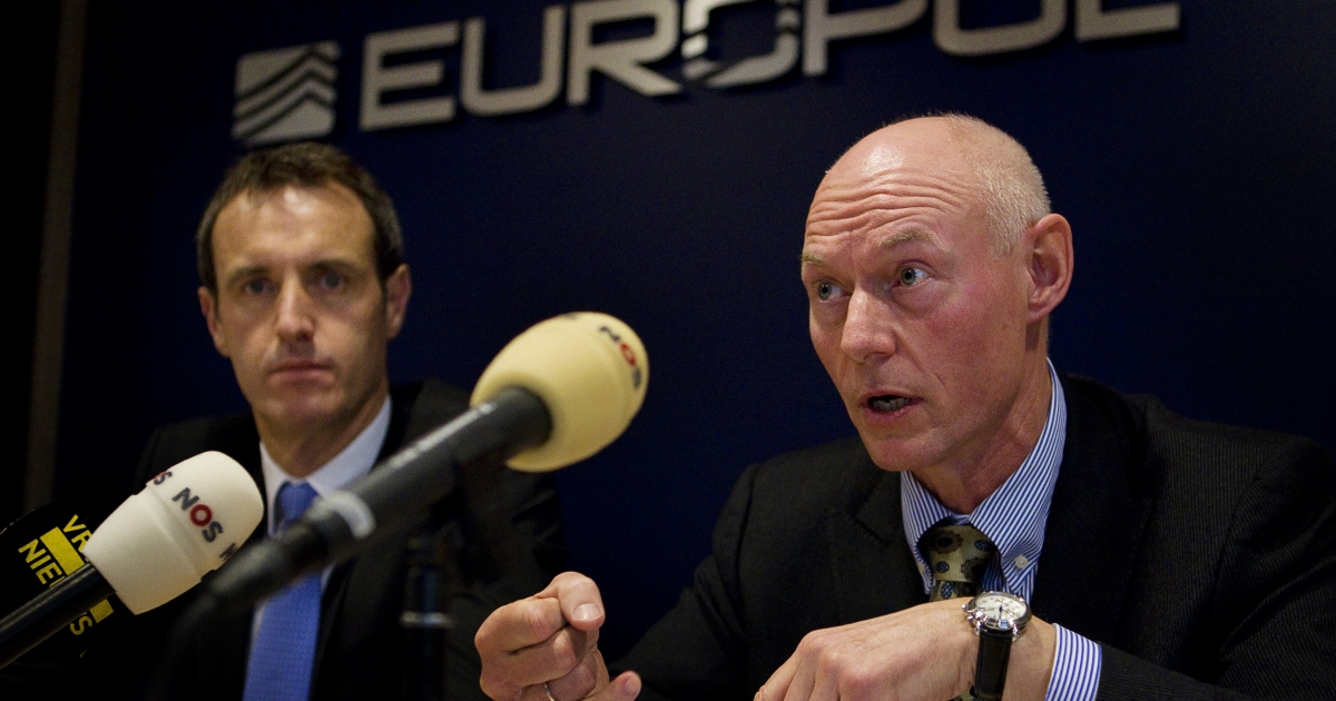 Denmark's national police chief Jens Henrik Hoejbjerg speaks next to Europol director Rob Wainwright during a press conference at Europol headquarters in The Hague, on December 16, 2011. Police in 22 European countries swooped on 112 suspects for allegedly sharing