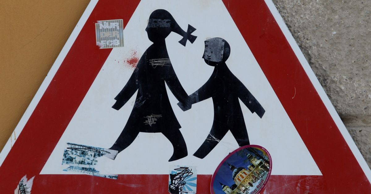 A traffic sign depicting children is pictured at the Benedictine-run Ettal Monastery is pictured in Ettal, Germany. Munich prosecutors opened an investigation into allegations of sexual abuse by priests made by 20 alumni of the Benedictine-run Ettal Monastery school in Bavaria, while a lawyer involved in the case charged that hundreds of boys had been beaten, many of them severely, by staff at the school decades ago.</p>