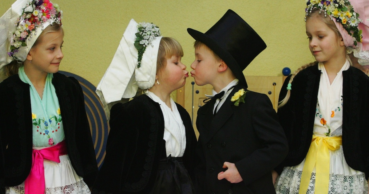 Child 'groom' Maurice (2nd from R) kisses his 'bride' Lenka during a traditional Sorbian 'birds wedding' at a kindergarten in Cottbus, eastern Germany. Children of Sorbian origin traditionally celebrate the symbolic wedding to greet the upcoming end of the winter. The Sorbs are a small west Slavic people, living as a minority in the German states of Saxony and Brandenburg.</p>