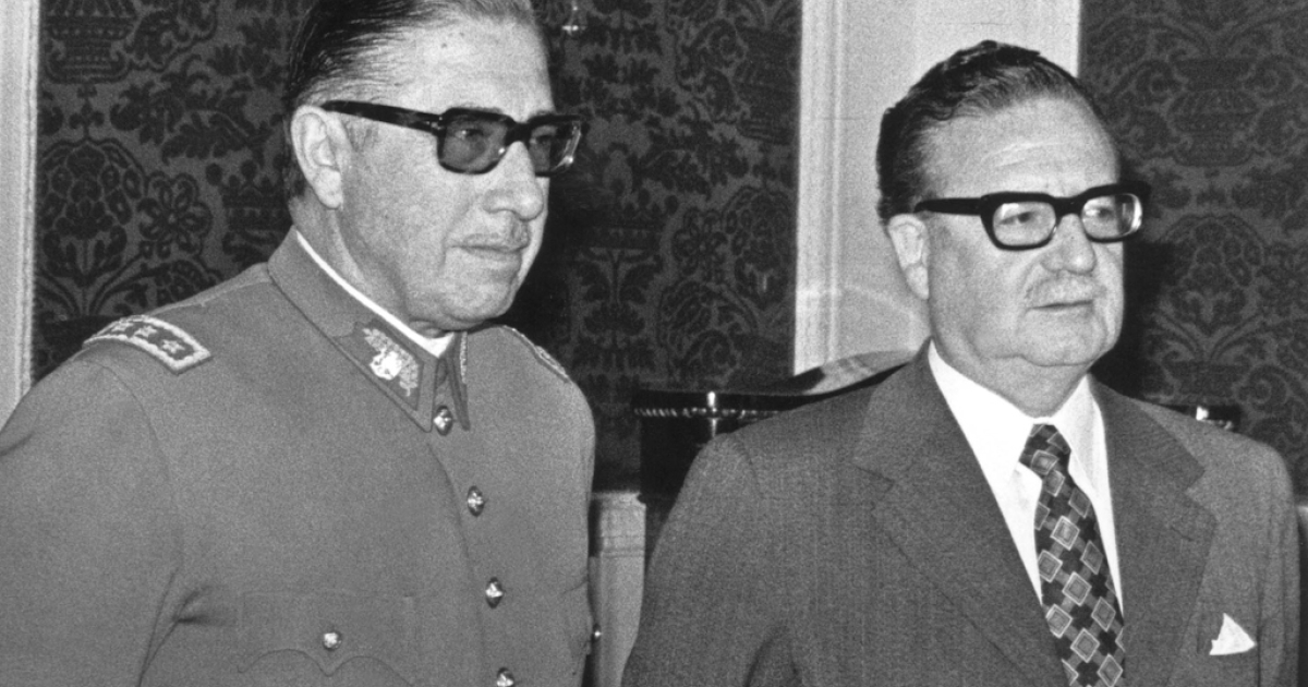 General Augusto Pinochet (L) poses with Chilean president Salvador Allende 23 August 1973 in Santiago, shortly after Allende appointed him the head of the army, just three weeks before Pinochet coup that killed Allende. A year later, in 1974, Pinochet signed a decree naming himself Chilean president.</p>