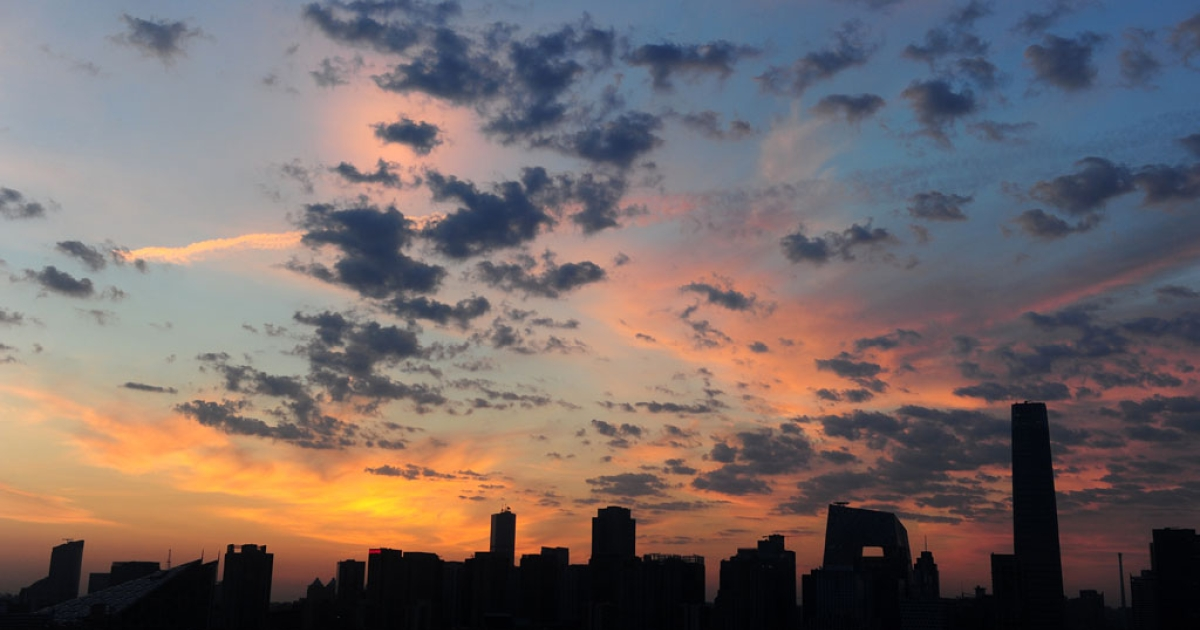 A new day breaks in Beijing on June 25, 2011 behind the central business district skyline with the city's tallest building, the China World Trade Tower 3.</p>