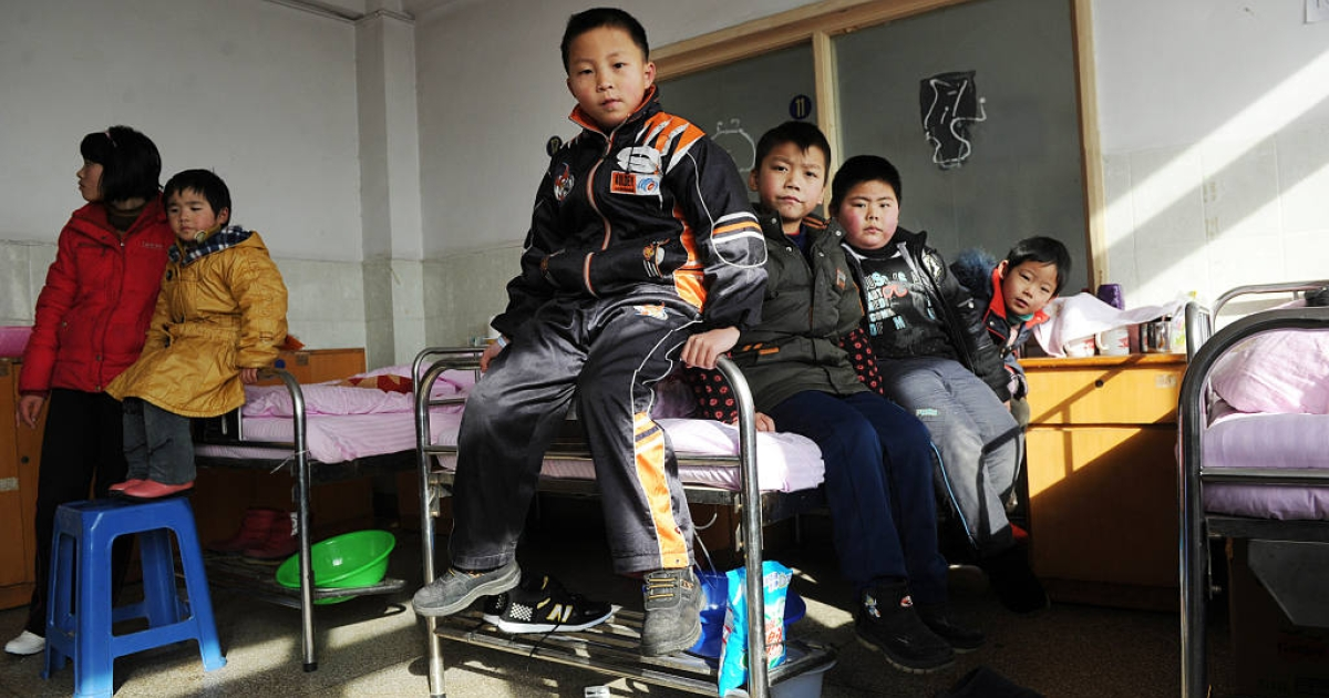 Chinese children waited for check ups at a hospital in Huaining, east China's Anhui province on January 8, 2011, after twenty-eight children were hospitalized for lead poisoning blamed on an unlicensed battery factory. On June 15, Human Rights Watch issued a report claiming that Chinese officials have been covering up the extent of the problem.</p>