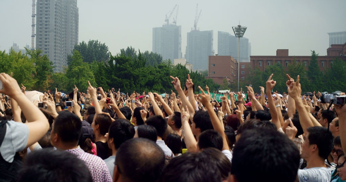 Chinese protesters demonstrate against the building of the Fujia chemical plant in Dalian, in northeast China's Liaoning province on Aug. 14, 2011.</p>