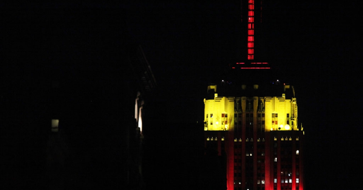 The Empire State Building is lit in red and yellow to mark the 60th anniversary of China's communist government September 30, 2009 in New York City. Perhaps the colors foreshadowed the recent investment Chinese real estate developers have made in the Empire State Building.</p>