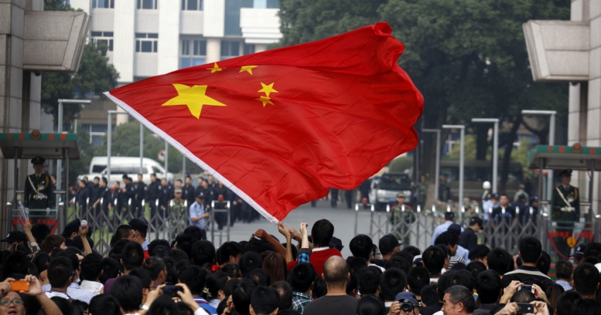 A Chinese protester waves the national flag Oct. 28, 2012  Ningbo, China.</p>