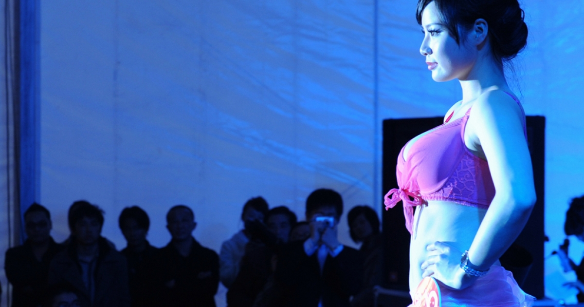 A Chinese model participates in a best breast model contest in Hefei, east China's Anhui province.</p>
