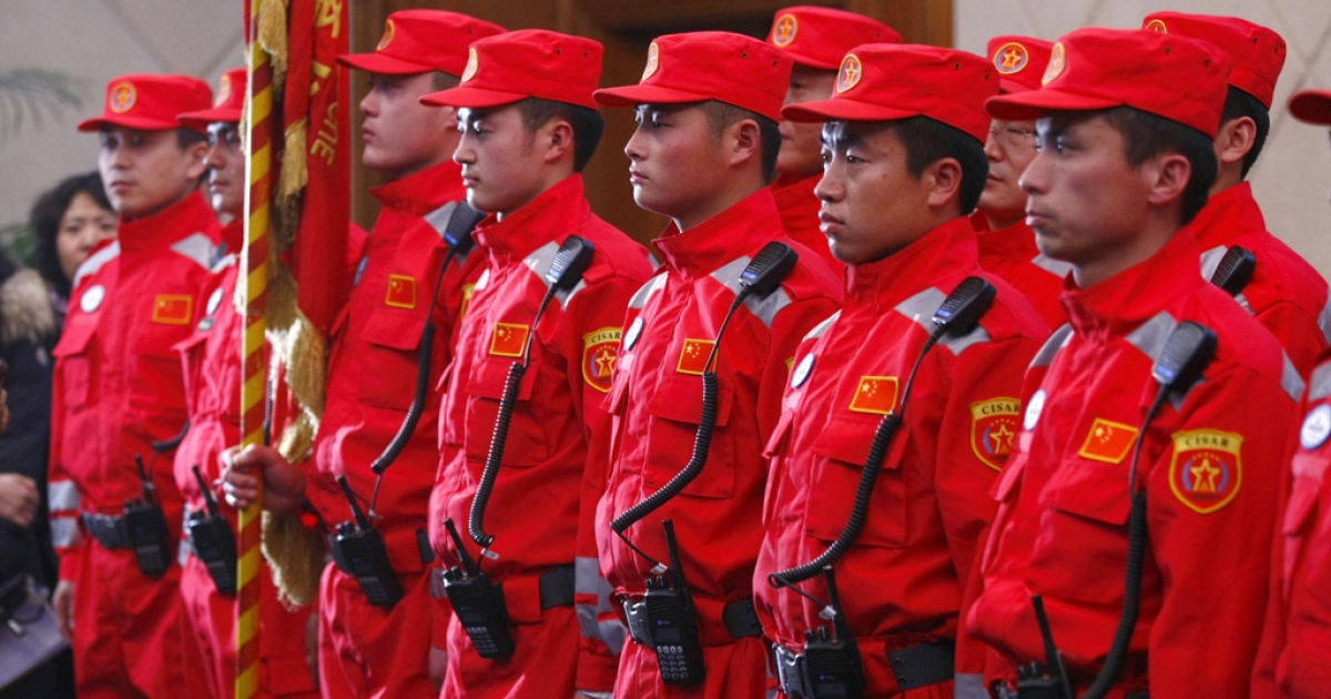Members of the Chinese rescue team prepare to depart to aid Japan, after the earthquake and tsunami, at the airport in Beijing on March 13, 2011. Premier Wen Jiabao expressed his