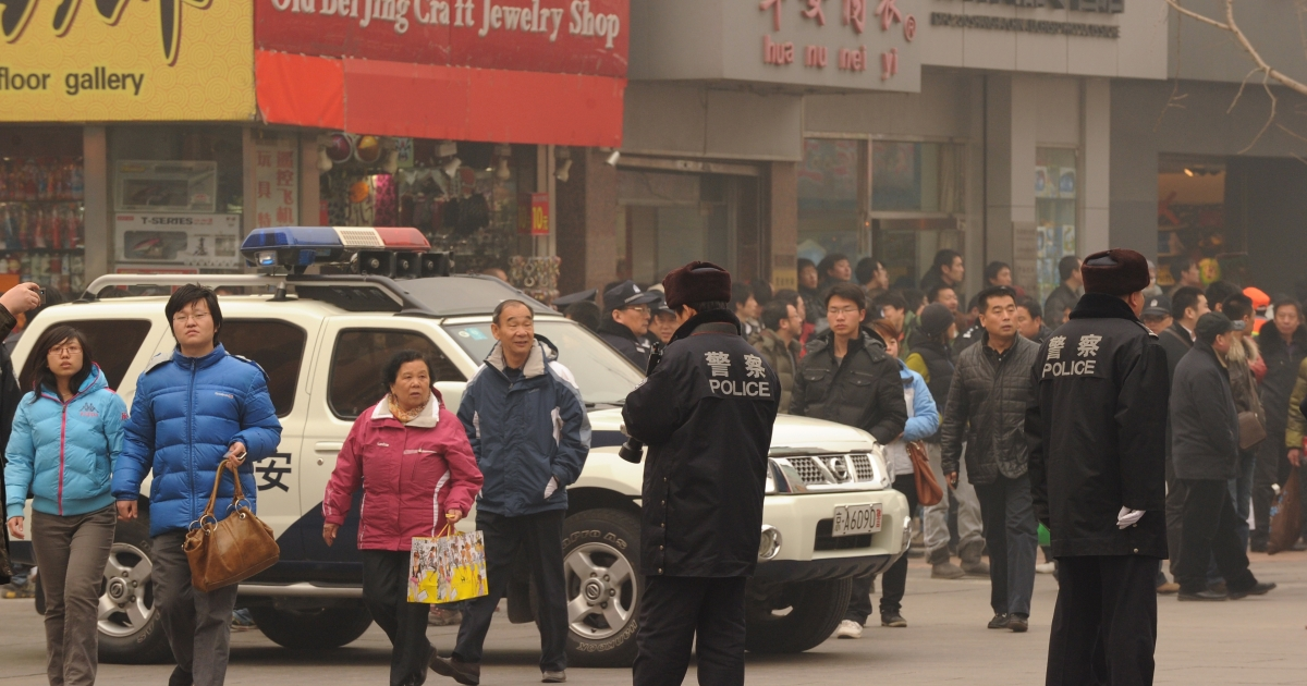 Police keep watch along the Wanfujing shopping street in Beijing after protesters gathered on Feb. 20, 2011. Postings circulating on the Internet called on disgruntled Chinese to gather in public places in 13 major cities to mark the