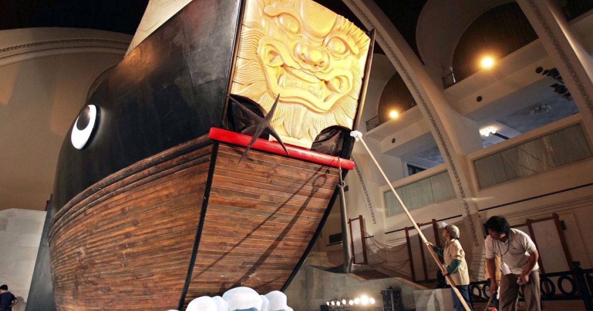 Workers clean a model of a Chinese ship sailed by Chinese explorer Zheng He. He led seven seven voyages in which he sailed from China to more than 30 countries and regions throughout the Indian Ocean and Persian Gulf from 1405 to 1433.</p>