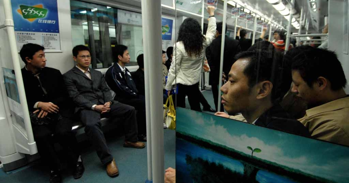 Commuters travel in the subway of Shenzhen.</p>