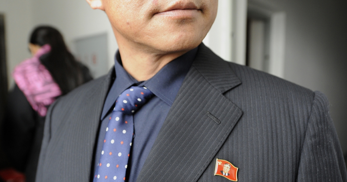 A North Korean man wearing a badge of late North Korean leader Kim Il Sung waits to pay his respects for late North Korean leader Kim Jong Il at an office of North Korean consulate in Chinese border city of Dandong on Dec. 21, 2011.</p>