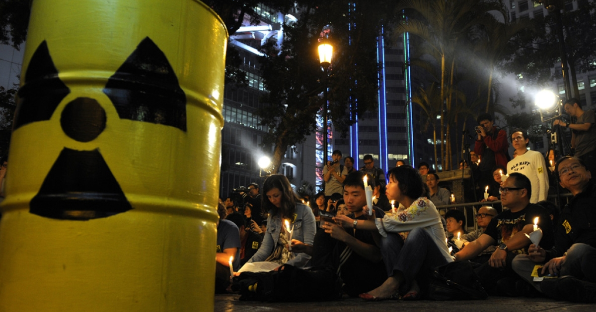 People attend a candle light vigil for victims of the recent Japan earthquake and tsunami in Hong Kong on March 20, 2011.</p>