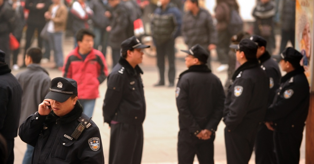 Police keep watch along the Wanfujing shopping street in Beijing after protesters gathered on Feb. 20, 2011.</p>