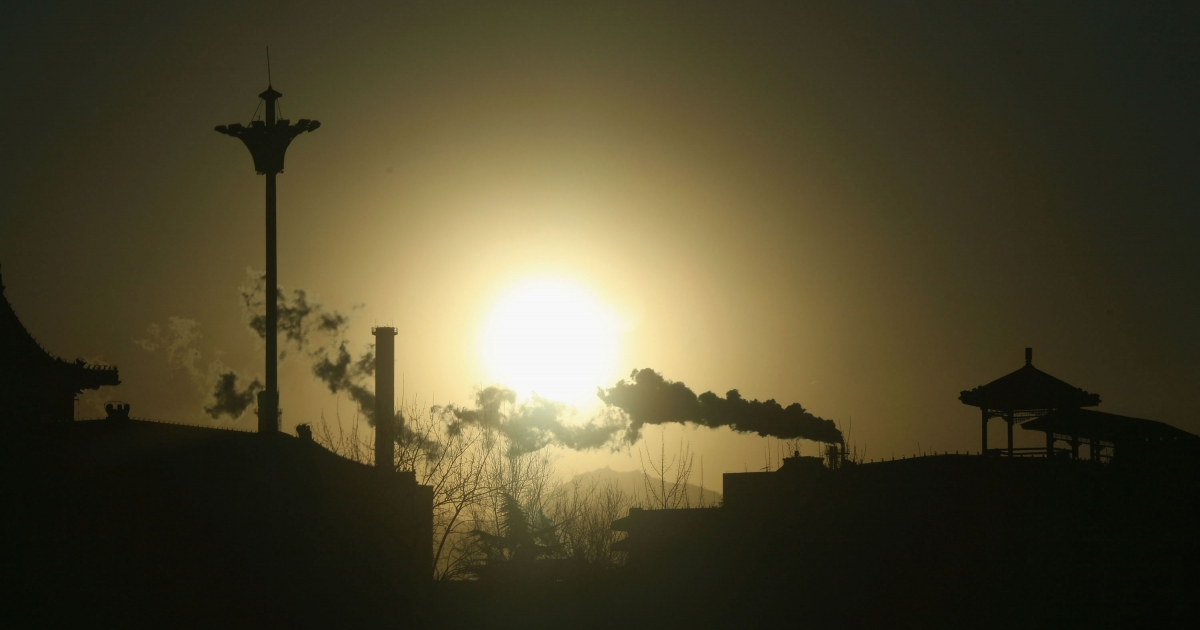 Chimneys belch out smoke at the Beijing Capital Steel Plant , which has long been blamed as Beijing's worst polluter, on January 31, 2007 in western suburbs of the Chinese capital.</p>