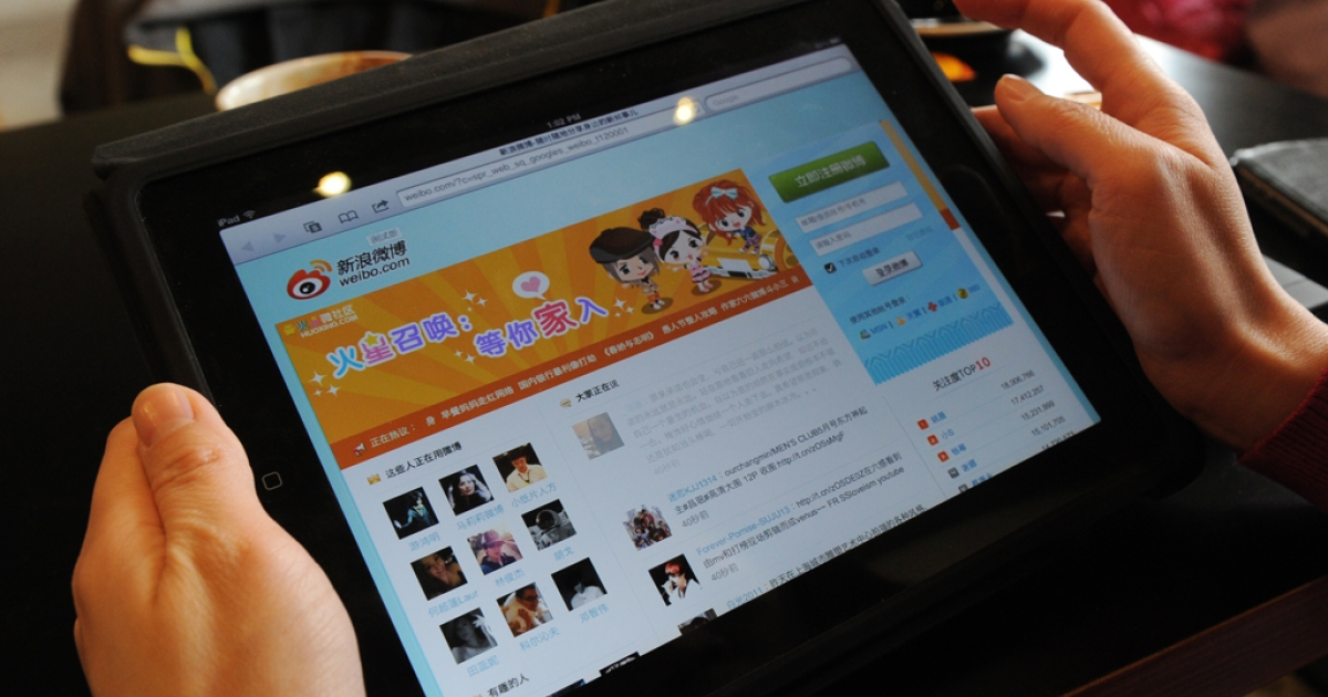 A woman views the Chinese social media website Weibo at a cafe in Beijing on April 2, 2012.</p>