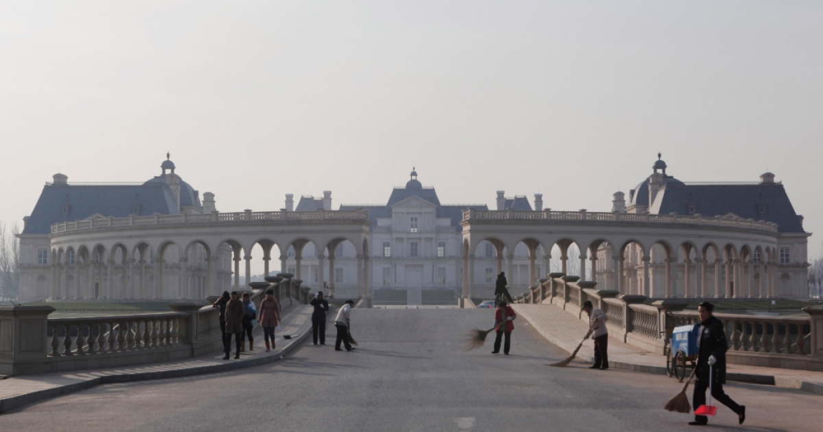 China's fondness for wine isn't new: workers clean the road at the Beijing Laffitte Chateau hotel on June 12, 2011 in Beijing, China. A multi-million dollar replica of France's historic Chateau Maison-Laffitte, the Beijing Laffitte Chateau located at the outskirt of Beijing, is a luxury hotel, spa and wine museum in one.</p>