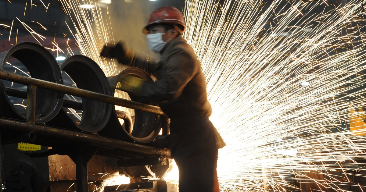 A worker at a steel mill in Hefei, in eastern China's Anhui province, on Dec. 23, 2010.</p>