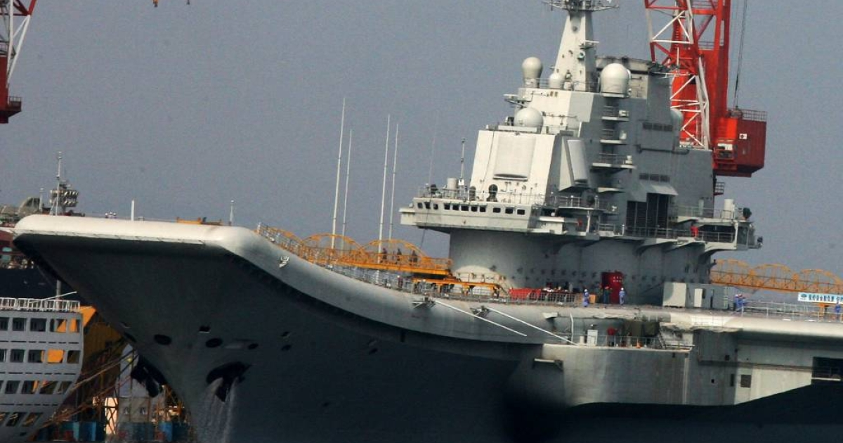 This photo taken on August 4, 2011 shows China's first aircraft carrier at the northeastern port of Dalian.</p>