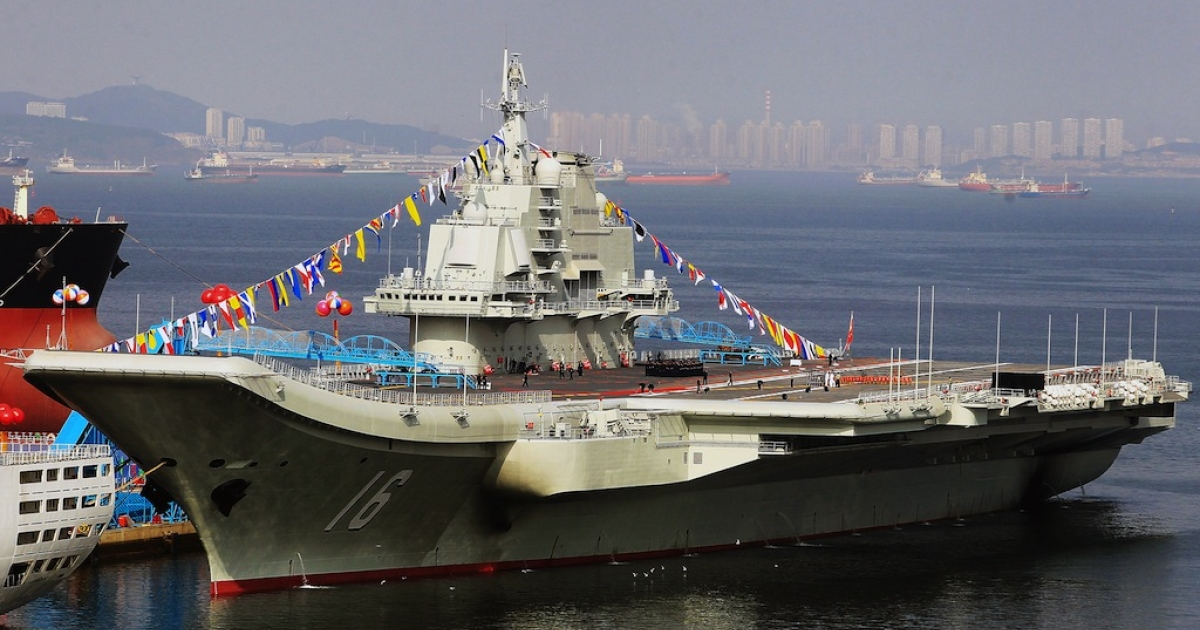 China's first aircraft carrier, a former Soviet carrier called the Varyag, docked after its handover to the People's Liberation Army (PLA) navy in Dalian, northeast China's Liaoning province on Sept. 24, 2012.</p>