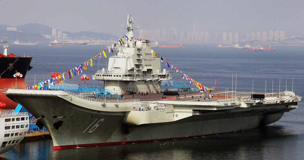 This photo taken on September 24, 2012 shows China's first aircraft carrier, a former Soviet carrier called the Varyag, docked after its handover to the People's Liberation Army (PLA) navy in Dalian, northeast China's Liaoning province.</p>