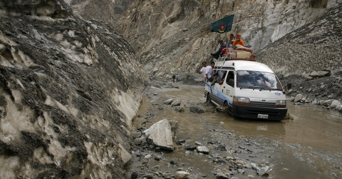 A car drives through a melting glacier on the Karakoram highway in Pakistan. Glaciers such as these are only one of the construction challenges China faces in modernizing the Karakoram highway.</p>