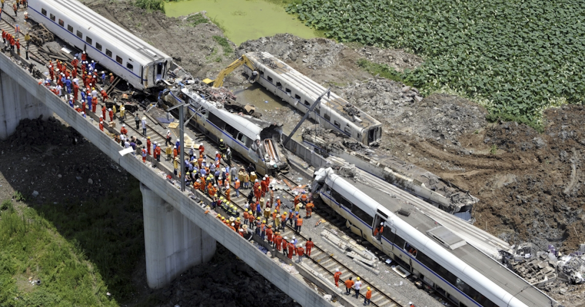 This aerial photo taken on July 24, 2011 shows rescue operations continuing on the wreckages of two high-speed trains that collided the night before in the town of Shuangyu, on the outskirts of Wenzhou in the eastern Chinese province of Zhejiang. China has ordered an 'urgent' overhaul of rail safety, state media said Sunday, after 43 people were killed in the worst accident ever to hit the country's high-speed train network. The collision of two trains in eastern China is likely to raise fresh questions over the rapid roll-out of the country's high-speed lines, the world's biggest at more than 5,000 miles.</p>