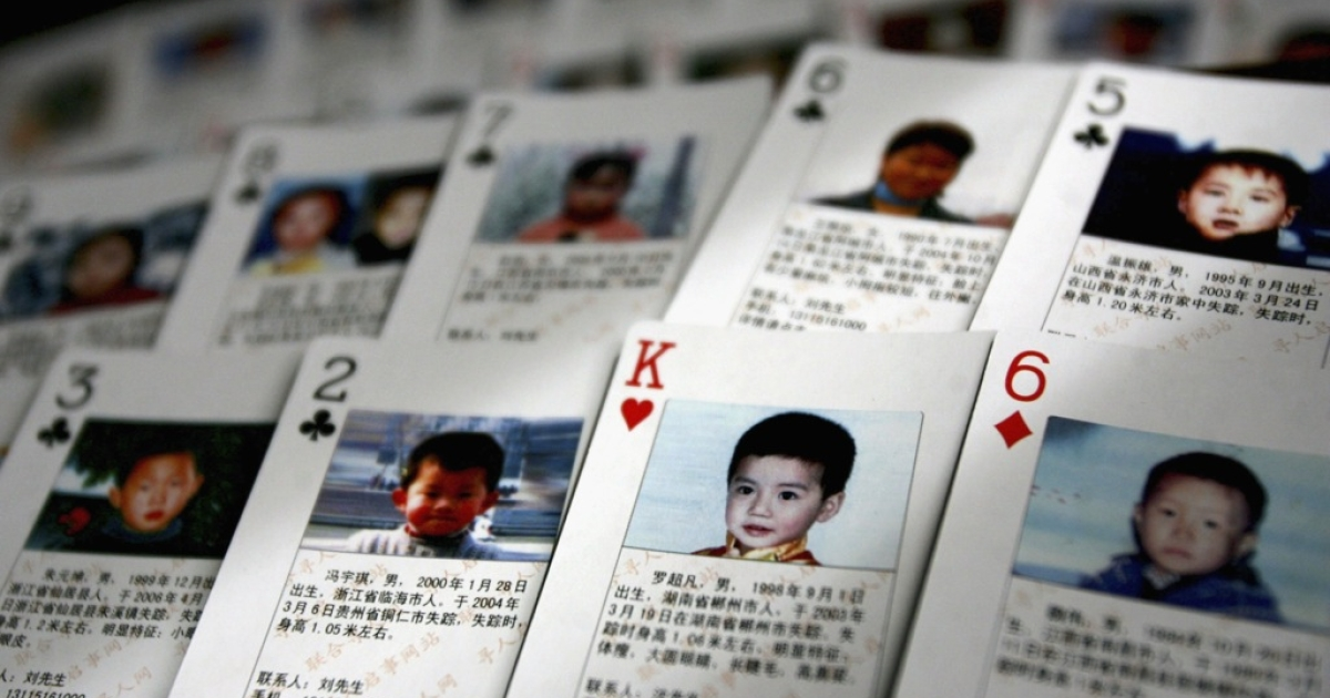 Playing cards showing details of missing children are displayed on March 31, 2007 in Beijing, China.</p>