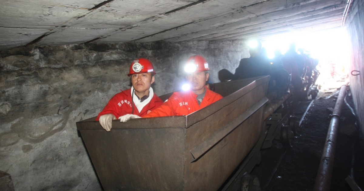 Rescuers prepare to enter a flooded coal pit to rescue trapped workers in Hengtai coal mine on August 24, 2011 in Qitaihe, Heilongjiang, China.</p>