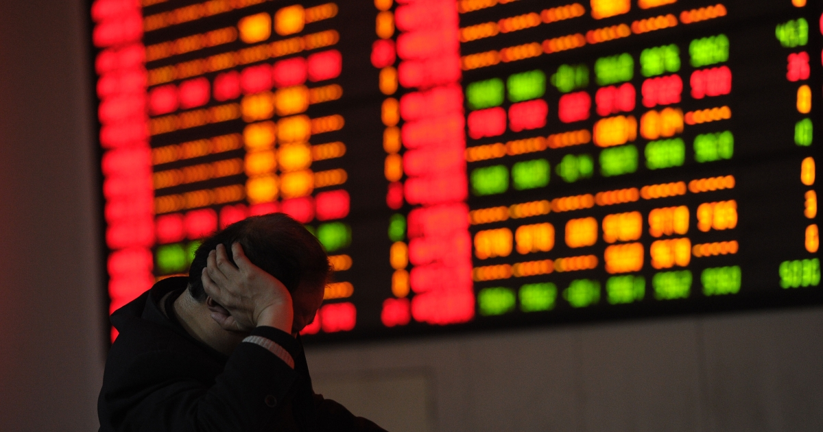 A Chinese stock investor checks his share prices at a security firm in Hefei, east China's Anhui province on February 22, 2012.</p>