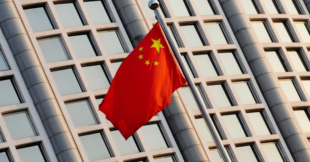 The Chinese flag flies outside the Foreign Ministry headquarters in Beijing.     AFP PHOTO/Mark RALSTON</p>