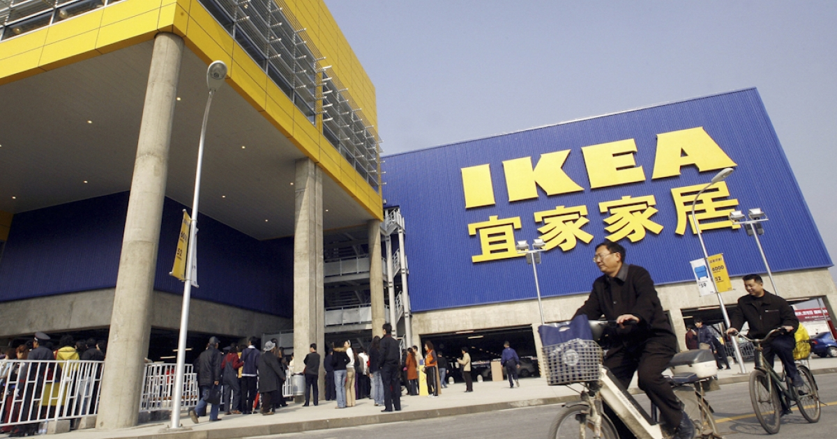 Customers cycle past a real Ikea shop in Chengdu, China. On the heels of the discovery of fake Apple stores in China, a store with a close resemblance to Ikea has been found, also in the southwestern Chinese city of Kunming.</p>