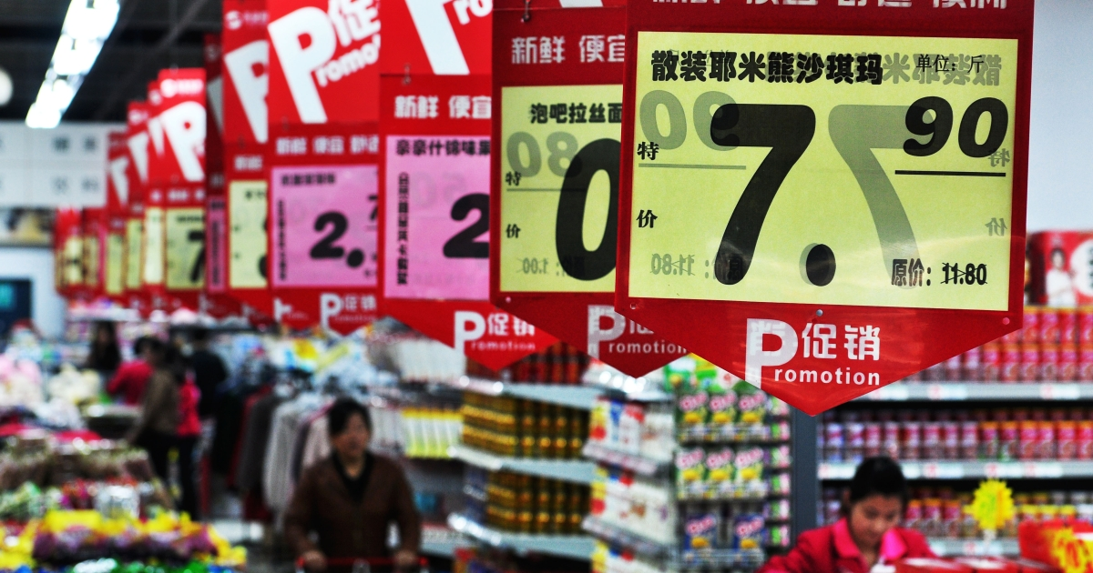 Customers shop at a supermarket in Zouping in northeast China's Shandong province on October 14, 2011. China in 2011 surpassed the US to become the world's largest grocery market, according to the Institute for Grocery Distribution.</p>