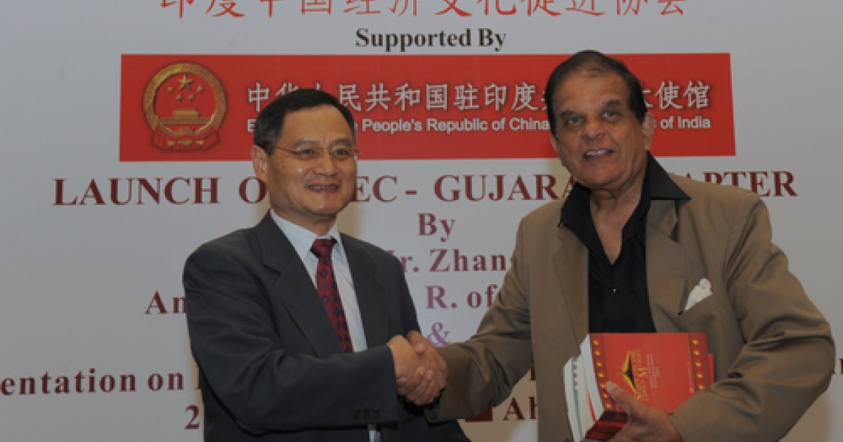Chinese Ambassador to India Zhang Yan (L) to India shakes hands with P.S Deodhar, President of the India/China Economic and Cultural Council, in Ahmedabad on August 26, 2011. Zhang Yan inaugurated the Gujarat Chapter of the India/China Economic and Cultural Council in Ahmedabad.</p>