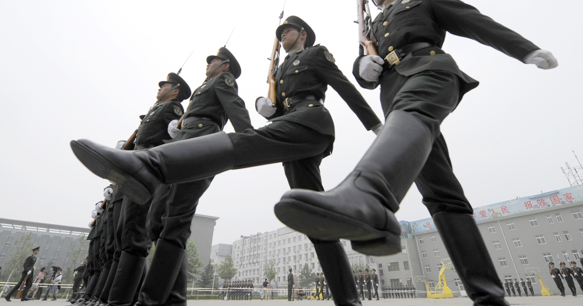 Chinese soldiers practice drills at a barracks in Beijing on July 21, 2011. The Chinese government has been implicated in a massive series of cyber attacks on U.S. defense firms and other international organizations.</p>