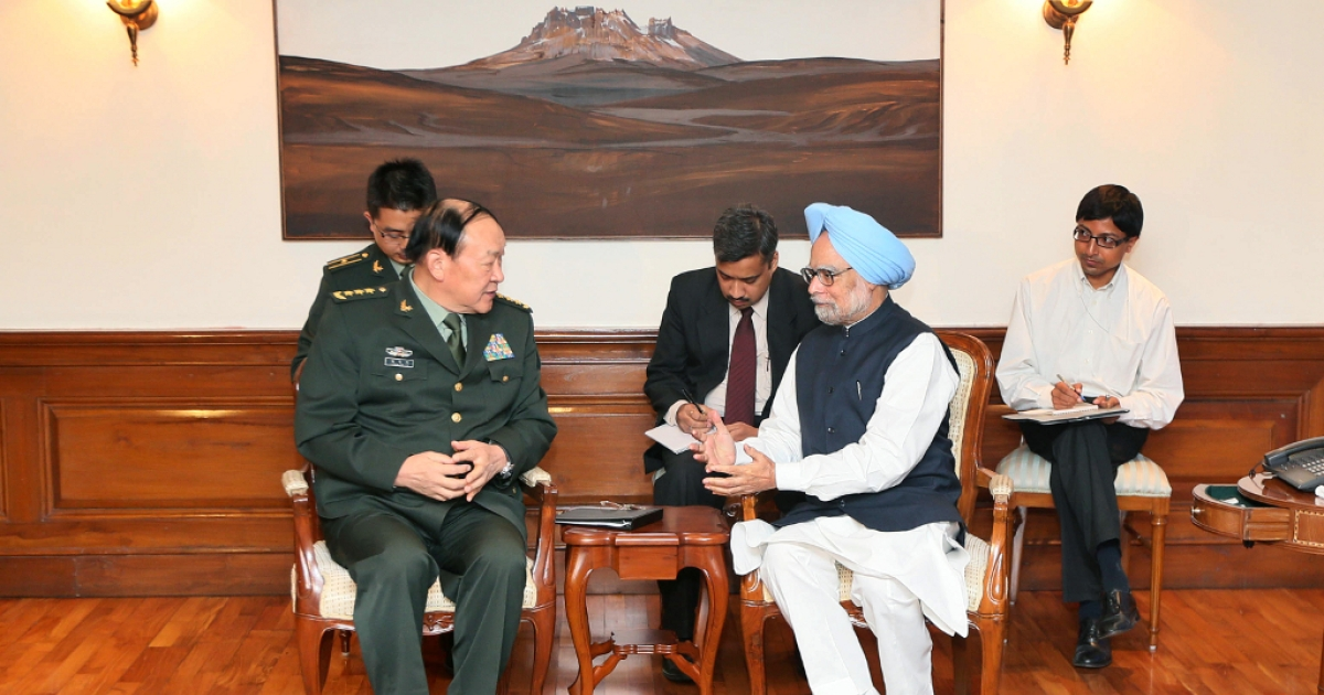 Chinese Defense Minister Liang Guanglie (L) and Indian Prime Minister Manmohan Singh (R) chat during a meeting in New Delhi on September 4, 2012. India and China announced Tuesday they would resume joint military exercises after a four-year gap, a move designed to build trust in the often prickly relationship between the world's two most populous nations.</p>