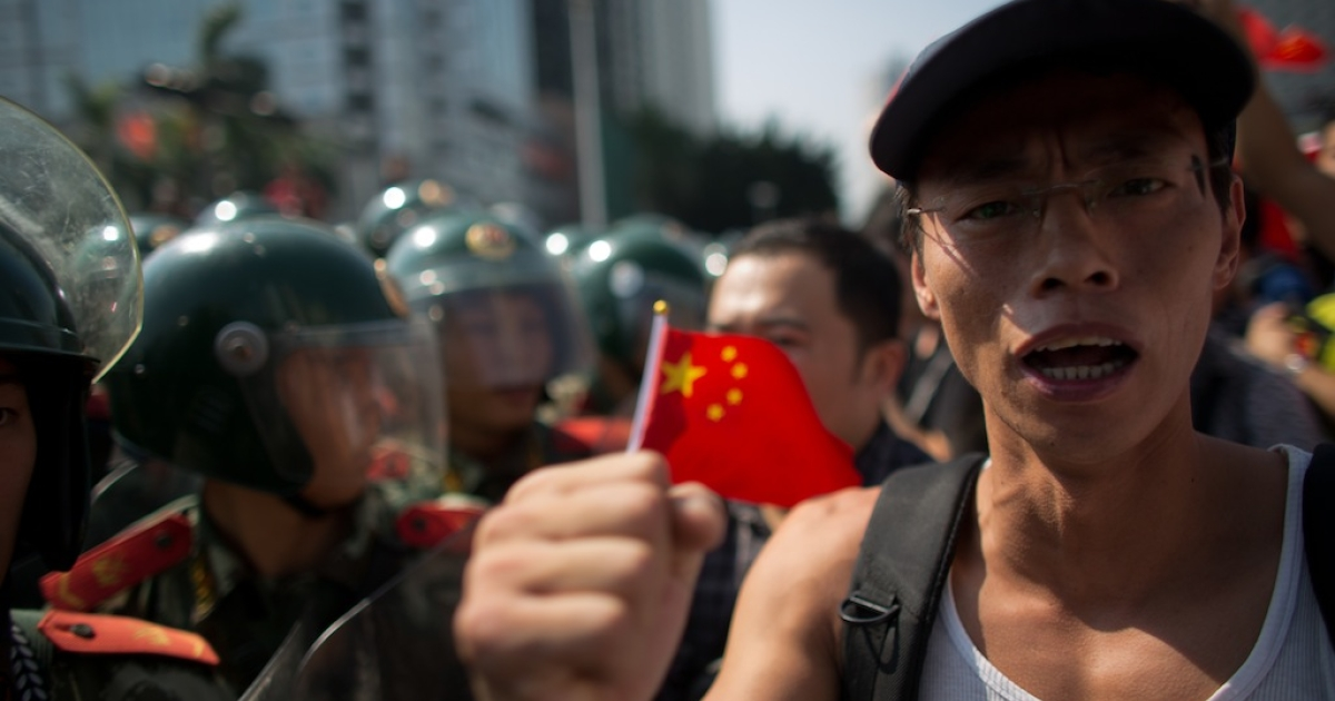 Anti-Japanese protesters are confronted by police as they demonstrate over the disputed Diaoyu Islands, on Sept. 16, 2012 in Shenzhen, China. Protests have taken place across China in a dispute that is becoming increasingly worrying for regional stability.</p>