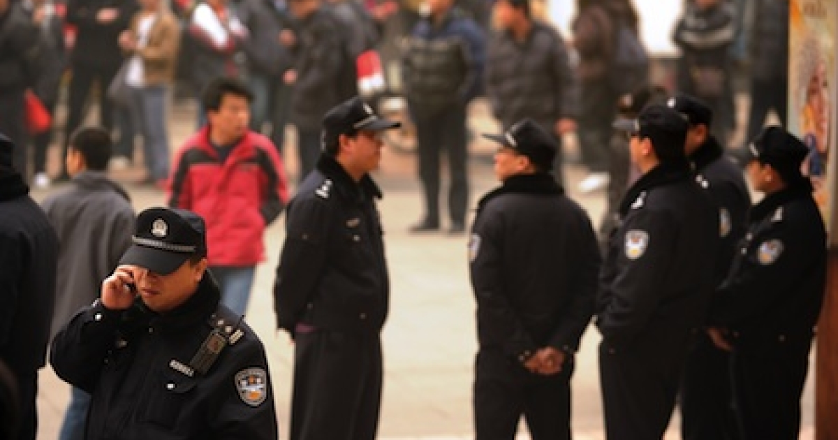 Police keep watch in Beijing in February, 2011, after Internet postings called on disgruntled Chinese to gather in protest.</p>