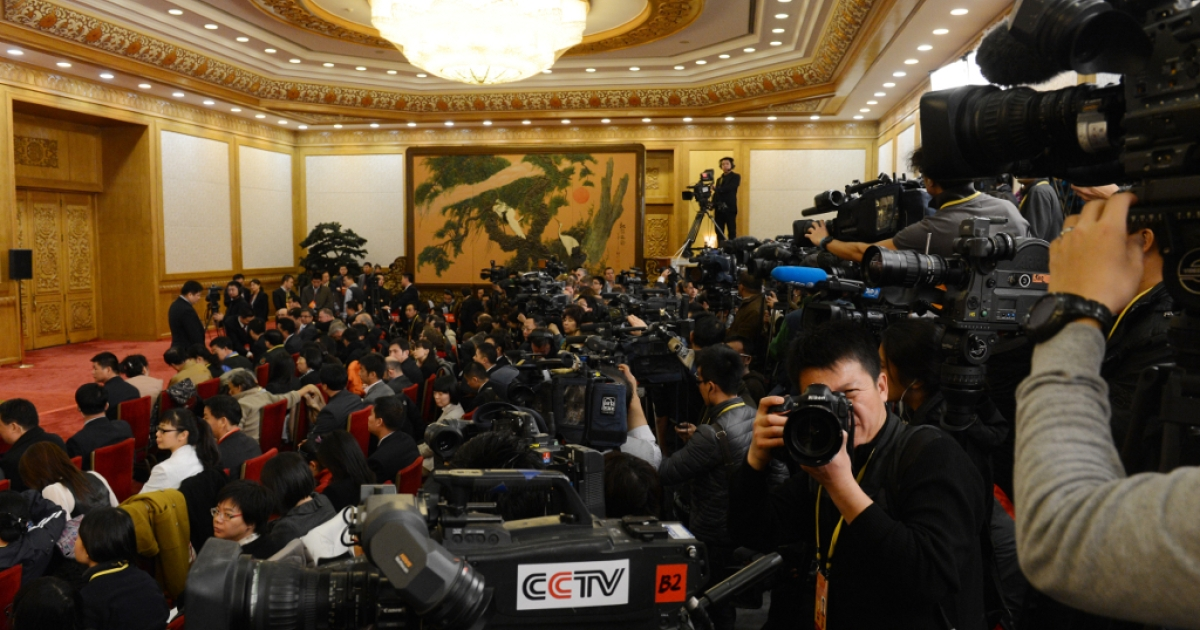 Journalists wait for the arrival of Chinese Vice President Xi Jinping after he was appointed as the head of the newly reshuffled seven-member Communist Party of China Politburo Standing Committee, the nation's top decision making body, at the Great Hall of the People in Beijing on Nov. 15, 2012.</p>
