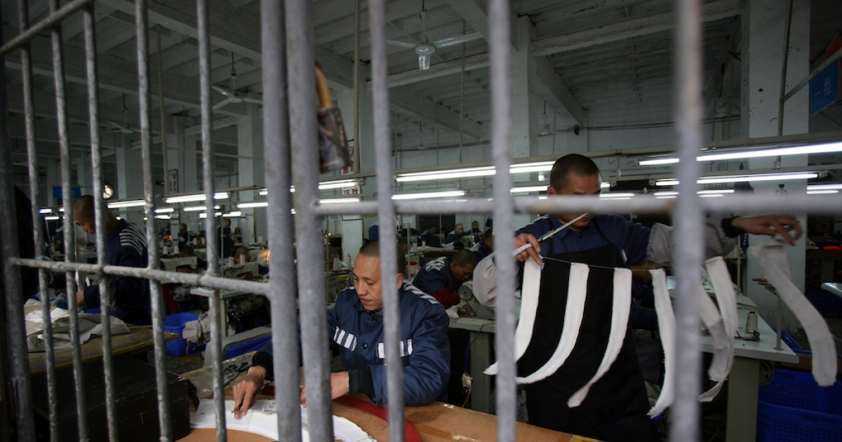 Had her appeal not been upheld, Tang faced over a year of hard labor, possibly in a sewing workshop like this one at a prison in Chongqing municipality, China. The prisons have been routinely criticized for inhumane treatment and terrible conditions.</p>