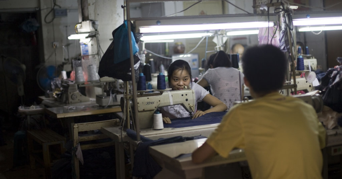Workers in a clothing factory in Haizhu, a textile manufacturing district in Guangzhou.</p>