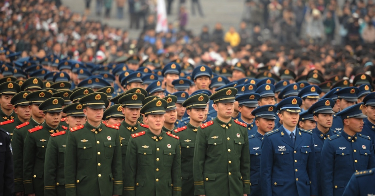 Chinese military personnel attend a ceremony for victims to mark the 75th anniversary of the Nanjing massacre at the Memorial Museum in Nanjing on December 13, 2012.</p>