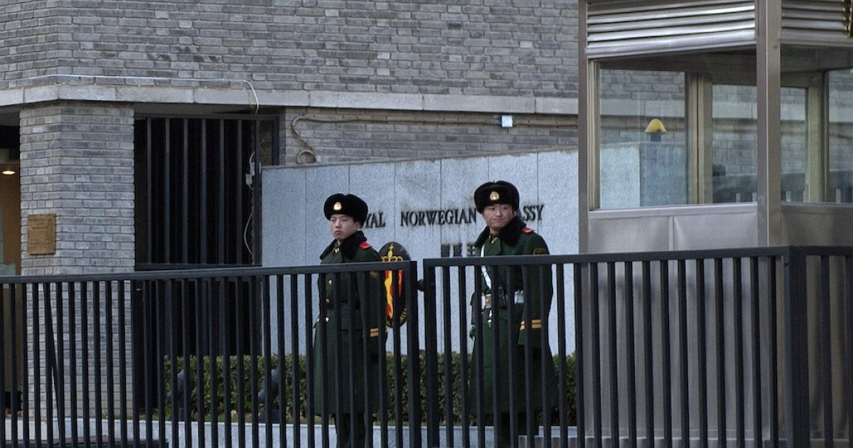 Two Chinese paramilitary guards stand outside the Norwegian embassy in Beijing on December 11, 2010. China lashed out at the 'political theatre' of the Nobel committee, saying its awarding the 2010 Peace Prize to jailed dissident Liu Xiaobo was a product of a 'Cold War mentality'.</p>