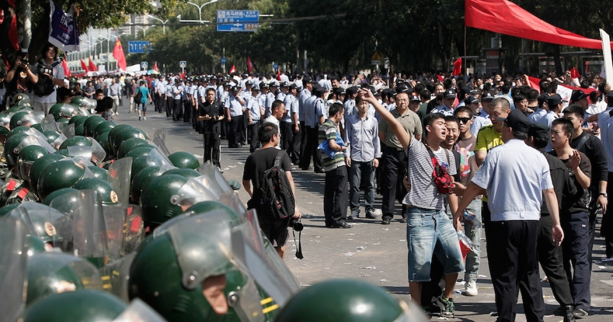 Chinese demonstrators stage an anti-Japanese protest over the disputed Diaoyu Islands, known as the Senkaku Islands in Japan, outside the Japanese Embassy on September 15, 2012 in Beijing, China.</p>