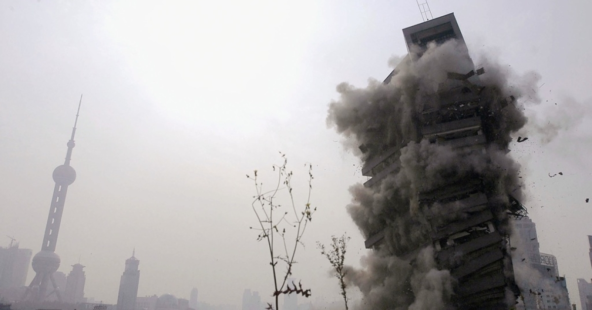 A 19-floor commercial building is demolished by controled explosions on November 17, 2004 in Shanghai, China's financial hub, to make way for new development.</p>
