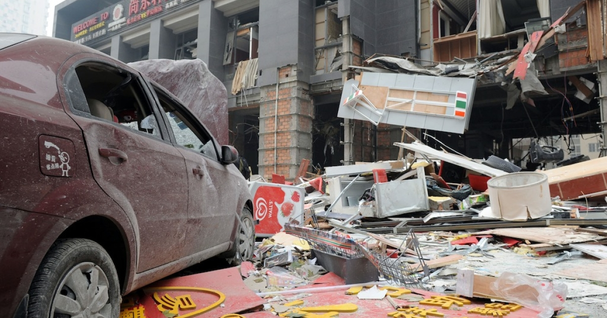 A view of an explosion site at Jiatian International Mansion on Nov. 14, 2011 in Xi an, Shaanxi Province of China. Seven people have been confirmed dead and 31 others injured after an explosion, caused by a liquefied petroleum gas leak.</p>