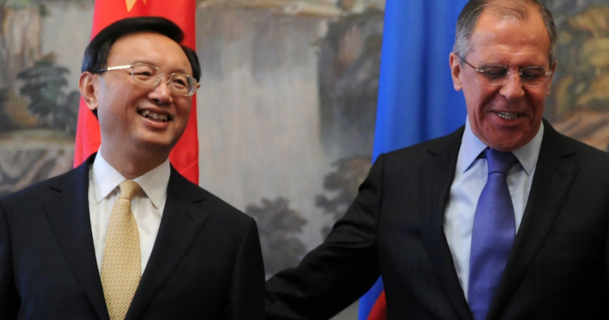 Russia's Foreign Minister Sergei Lavrov (R) hugs his Chinese counterpart Yang Jiechi (L) in Moscow, on April 13, 2012.</p>