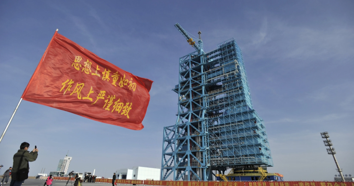 A man takes a photo of an upgraded Long March 2F rocket carrying the Shenzhou-8 spacecraft at the Jiuquan Satellite Launch Center in Jiuquan, northwest China's Gansu province on October 31, 2011. China said it will launch an unmanned spacecraft on November 1, taking its next step towards the goal of building its first space station by 2020.</p>