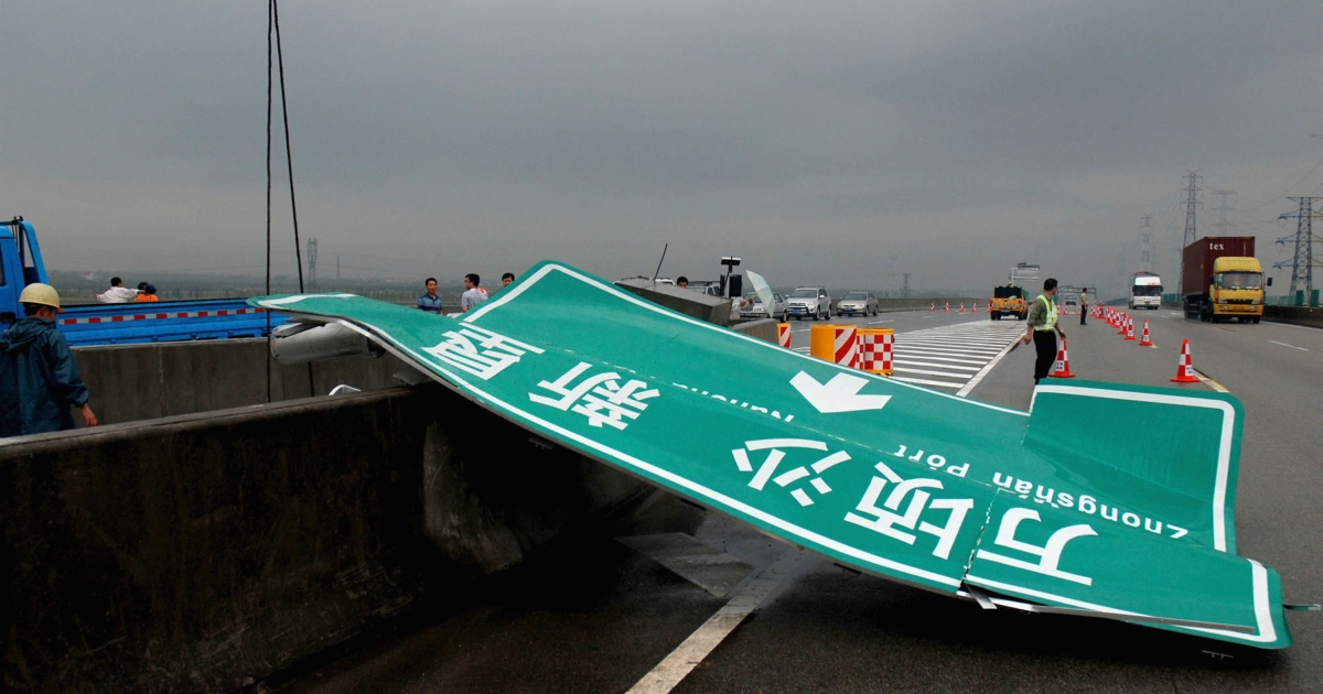 A road sign is seen damaged after a wind storm on April 17, 2011 in Guangzhou, Guangdong Province of China. According to flood control authorities on Monday, gales as strong as 100 miles an hour, accompanied by hailstorm, cloudburst and strong wind battered cities including Guangzhou, Foshan, Zhaoqing and Dongguan of south China's Guangdong Province on Sunday, has killed up to 18 people.</p>