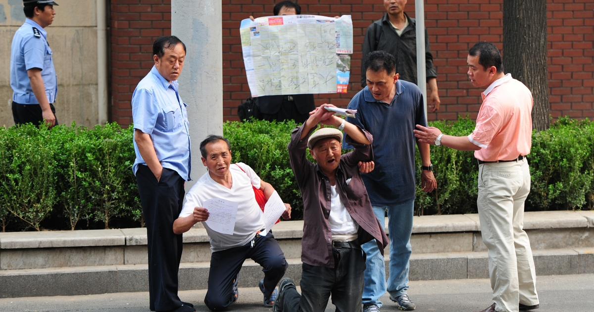 Petitioners protesting land grabs in China. A woman blew herself up in protest of having her home demolished in the Yunnan province on May 10, 2012.</p>